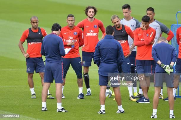 Lucas Neymar Jr and Adrien Rabiot of Paris SaintGermain react before a Paris SaintGermain training session at Centre Ooredoo on September 6 2017 in...