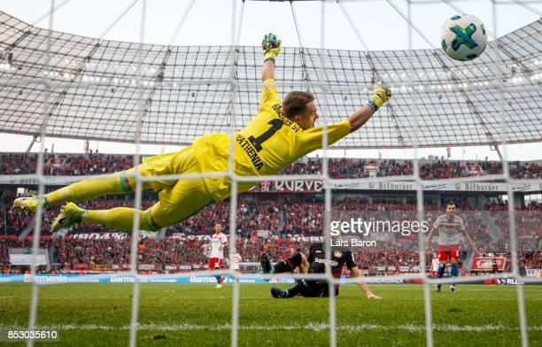 Lucas Nicolas Alario of Bayer Leverkusen scores his teams second goal against Christian Mathenia of Hamburg during the Bundesliga match between Bayer...