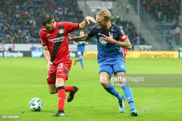 Lucas Nicolas Alario of Leverkusen and Kevin Vogt of Hoffenheim battle for the ball during the Bundesliga match between TSG 1899 Hoffenheim and Bayer...