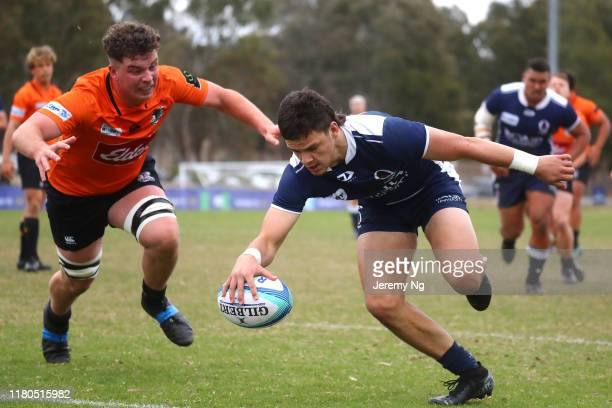 Lucas Niedzwiecki of Queensland Country scores a try during the National U19s Championship 3rd Place Play-Off between NSW Country URC and Queensland...