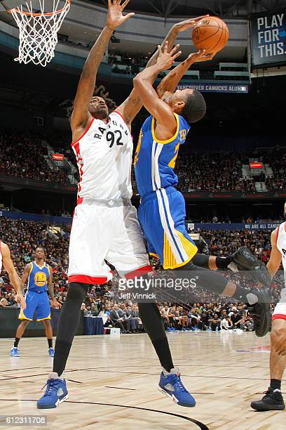 Lucas Nogueira of the Toronto Raptors blocks a shot against Phil Pressey of the Golden State Warriors during a preseason game on October 1 2016 at...