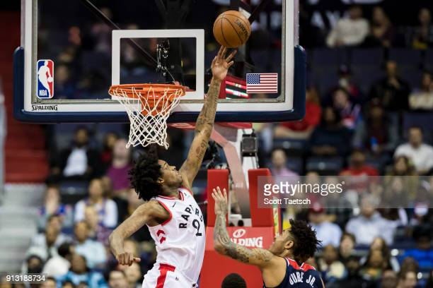Lucas Nogueira of the Toronto Raptors blocks the shot of Kelly Oubre Jr #12 of the Washington Wizards in the first half at Capital One Arena on...