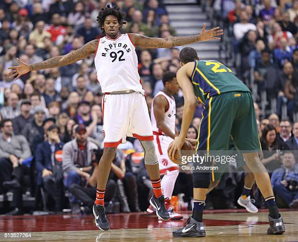 Lucas Nogueira of the Toronto Raptors defends against Rudy Gobert of the Utah Jazz during an NBA game at the Air Canada Centre on March 2 2016 in...