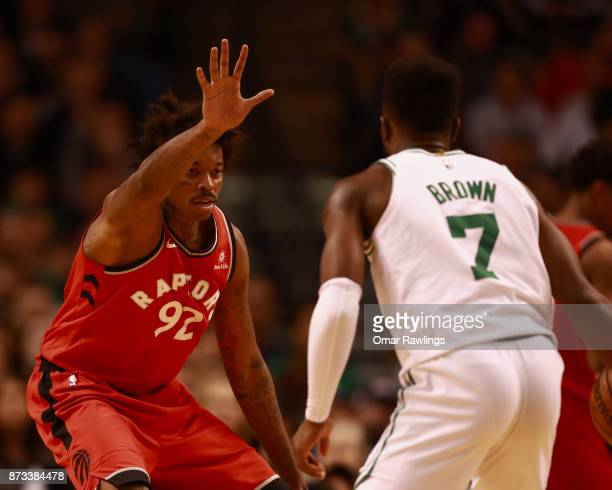 Lucas Nogueira of the Toronto Raptors defends Jaylen Brown of the Boston Celtics during the third quarter of the game at TD Garden on November 12...