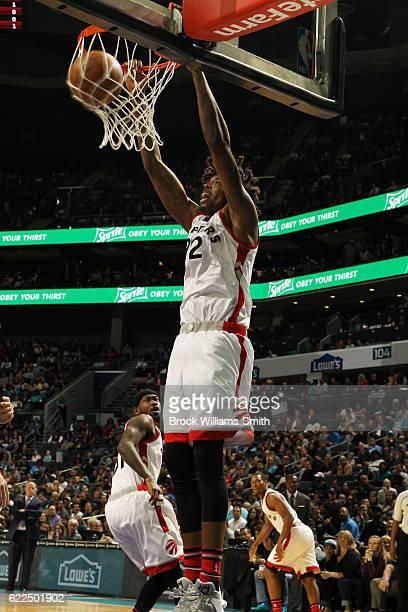 Lucas Nogueira of the Toronto Raptors dunks against the Charlotte Hornets on November 11 2016 at Time Warner Cable Arena in Charlotte North Carolina...