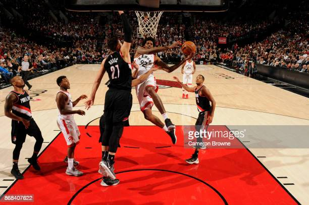 Lucas Nogueira of the Toronto Raptors goes to the basket against the Portland Trail Blazers on October 30 2017 at the Moda Center in Portland Oregon...