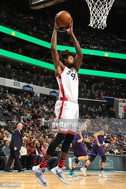 Lucas Nogueira of the Toronto Raptors grabs the rebound against the Charlotte Hornets on November 11 2016 at Time Warner Cable Arena in Charlotte...