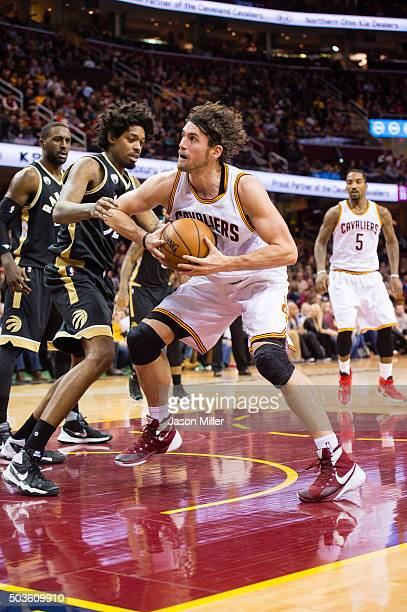 Lucas Nogueira of the Toronto Raptors guards Kevin Love of the Cleveland Cavaliers during the second half at Quicken Loans Arena on January 4 2016 in...