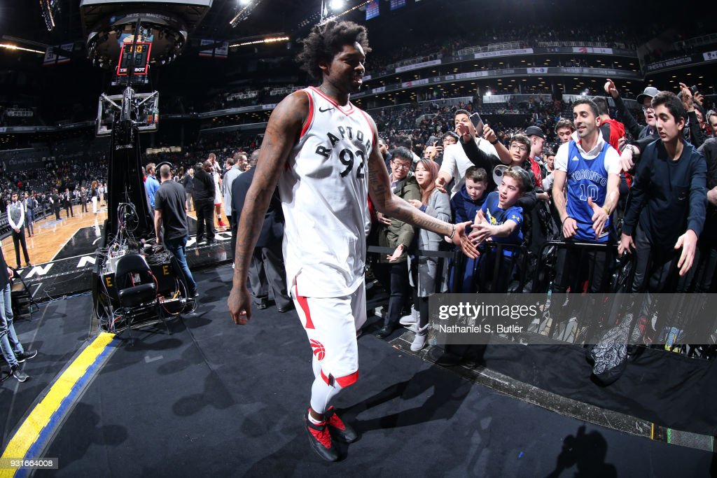 Lucas Nogueira #92 of the Toronto Raptors high fives fans after the game against the Brooklyn Nets on March 13, 2018 at Barclays Center in Brooklyn, New York.