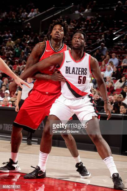 Lucas Nogueira of the Toronto Raptors is boxed out by Caleb Swanigan of the Portland Trail Blazers during the preseason game on October 5 2017 at the...