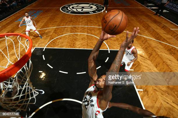 Lucas Nogueira of the Toronto Raptors rebounds the ball during the game against the Brooklyn Nets on January 8 2018 at Barclays Center in Brooklyn...