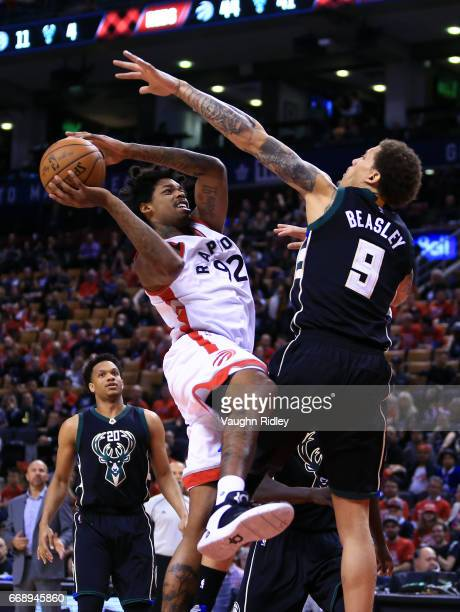Lucas Nogueira of the Toronto Raptors shoots the ball as Michael Beasley of the Milwaukee Bucks defends in the second half of Game One of the Eastern...