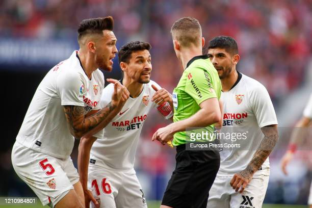 Lucas Ocampos and Jesus Navas of Sevilla protest during the Spanish League La Liga football match played between Atletico de Madrid and Sevilla FC at...