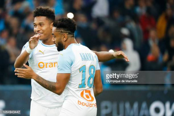 Lucas Ocampos and Jordan Amavi of Olympique de Marseille react during the ligue 1 match between Olympique de Marseille and Paris Saint Germain at...