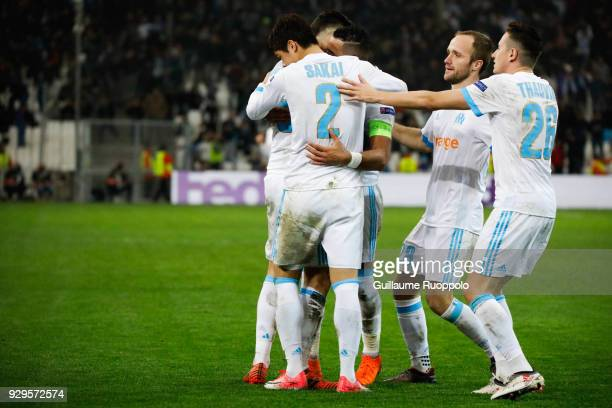 Lucas Ocampos celebrates his goal with Hiroki Sakai Valere Germain and Florian Thauvin of Marseille during the UEFA Europa League Round of 16 First...