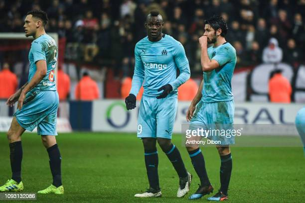 Lucas Ocampos Mario Balotelli and Morgan Sanson of Marseille dejected during the Ligue 1 match between Reims and Marseille at Stade Auguste Delaune...