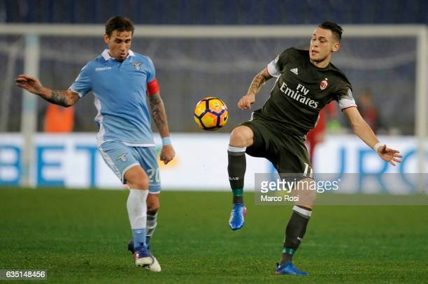 Lucas Ocampos of AC Milan compete for the ball with Lucas Biglia of SS Lazio during the Serie A match between SS Lazio and AC Milan at Stadio...