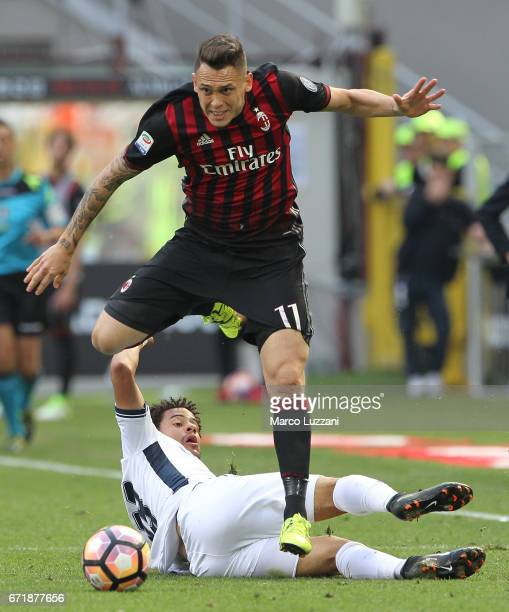 Lucas Ocampos of AC Milan competes for the ball with Andres Tello of Empoli FC during the Serie A match between AC Milan and Empoli FC at Stadio...