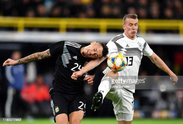 Lucas Ocampos of Argentina and Lukas Klostermann of Germany clash during the International Friendly between Germany and Argentina at Signal Iduna...
