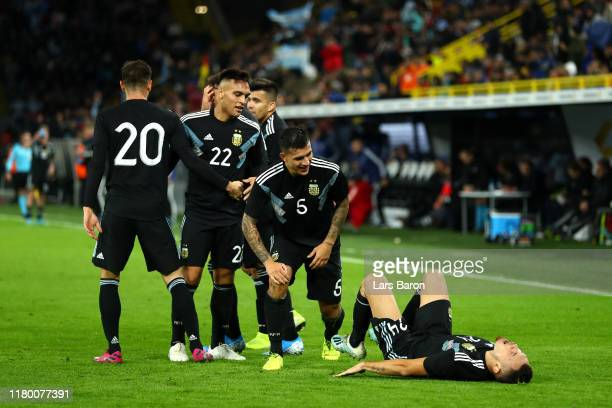 Lucas Ocampos of Argentina celebrates with teammates after scoring his team's second goal during the International Friendly match between Germany and...