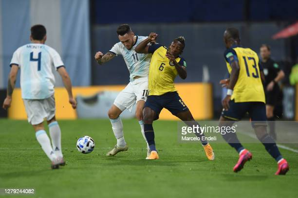 Lucas Ocampos of Argentina fights for the ball with Pervis Estupiñán of Ecuador during a match between Argentina and Ecuador as part of South...