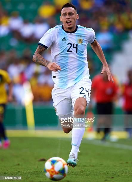 Lucas Ocampos of Argentina runs with the ball during the international friendly match between Ecuador and Argentina at Estadio Manuel Martinez Valero...
