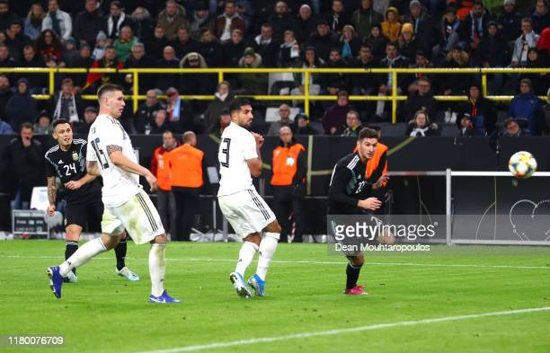 Lucas Ocampos of Argentina scores his sides second goal during the International Friendly between Germany and Argentina at Signal Iduna Park on...