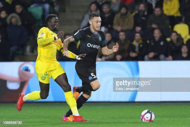 Lucas Ocampos of Marseille and Abdoulaye Toure of Nantes during the French Ligue 1 match between FC Nantes and Olympique de Marseille on December 5...