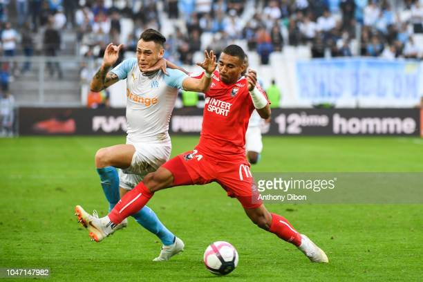 Lucas Ocampos of Marseille and Alexander Djiku of Caen during the Ligue 1 match between Marseille and Caen at Stade Velodrome on October 7 2018 in...
