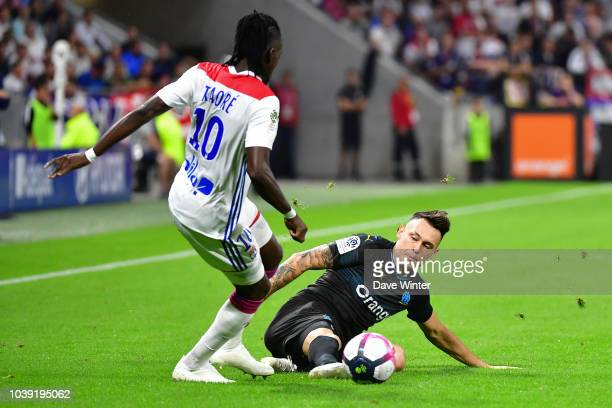 Lucas Ocampos of Marseille and Bertrand Traore of Lyon during the Ligue 1 match between Lyon and Marseille at the Groupama Stadium on September 23...