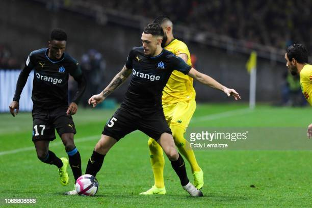 Lucas Ocampos of Marseille and Bouna Sarr of Marseille during the French Ligue 1 match between FC Nantes and Olympique de Marseille on December 5...