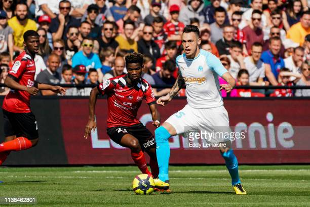 Lucas Ocampos of Marseille and Didier Ndong of Guingamp during the Ligue 1 match between EA Guingamp and Olympique de Marseille at Stade du Roudourou...