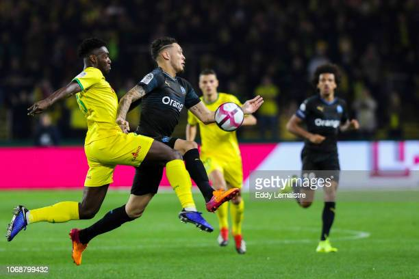 Lucas Ocampos of Marseille and Enock Kwateng of Nantes during the French Ligue 1 match between FC Nantes and Olympique de Marseille on December 5...