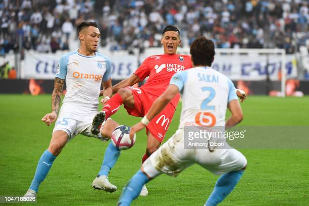 Lucas Ocampos of Marseille and Faycal Fajr of Caen during the Ligue 1 match between Marseille and Caen at Stade Velodrome on October 7 2018 in...
