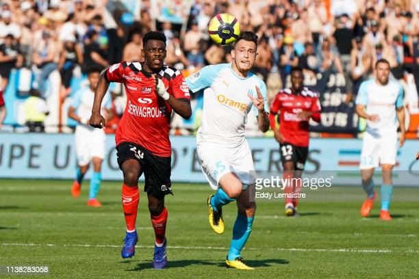 Lucas Ocampos of Marseille and Felix Eboa Eboa of Guingamp during the Ligue 1 match between EA Guingamp and Olympique de Marseille at Stade du...