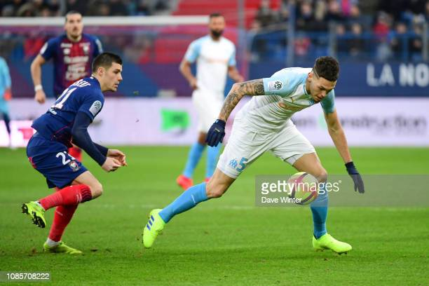 Lucas Ocampos of Marseille and Frederic Guilbert of Caen during the Ligue 1 match between Caen and Marseille at Stade Michel D'Ornano on January 20...