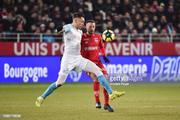 Lucas OCAMPOS of Marseille and Jordan MARIE of Dijon during the Ligue 1 match between Dijon and Marseille at Stade Gaston Gerard on February 8 2019...