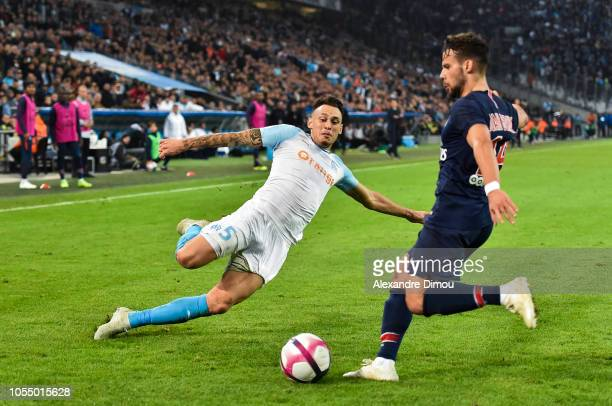 Lucas Ocampos of Marseille and Juan Bernat of Paris during the Ligue 1 match between Olympique Marseille and Paris Saint Germain on October 28 2018...