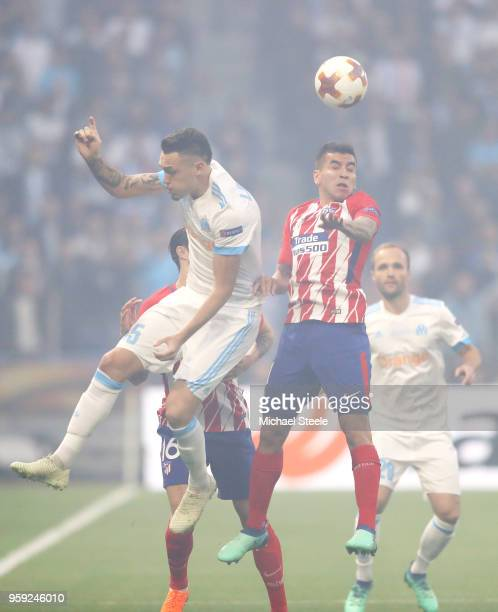 Lucas Ocampos of Marseille and Kevin Gameiro of Atletico Madrid battle for an aerial ball during the UEFA Europa League Final between Olympique de...