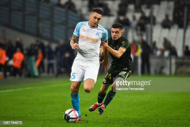 Lucas Ocampos of Marseille and Mathieu Cafaro of Reims during the French Ligue 1 football match between Olympique Marseille and Stade de Reims on...