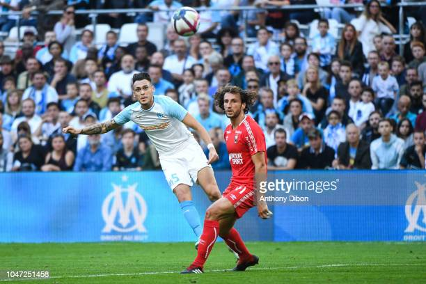 Lucas Ocampos of Marseille and Paul Baysse of Caen during the Ligue 1 match between Marseille and Caen at Stade Velodrome on October 7 2018 in...