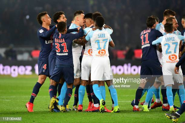 Lucas Ocampos of Marseille and Presnel Kimpembe of PSG get into an altercation during the Ligue 1 match between Paris Saint Germain and Marseille at...
