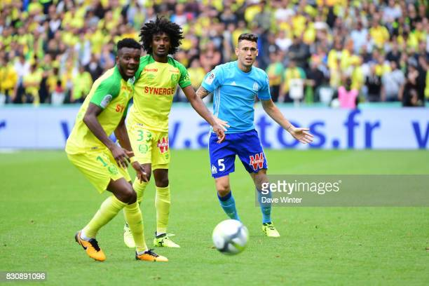 Lucas Ocampos of Marseille and Samuel Moutoussamy of Nantes and Chidozie Awaziem of Nantes during the Ligue 1 match between FC Nantes and Olympique...