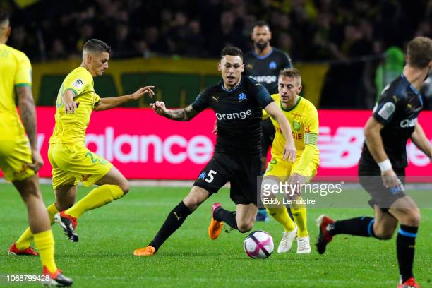Lucas Ocampos of Marseille and Valentin Rongier of Nantes during the French Ligue 1 match between FC Nantes and Olympique de Marseille on December 5...