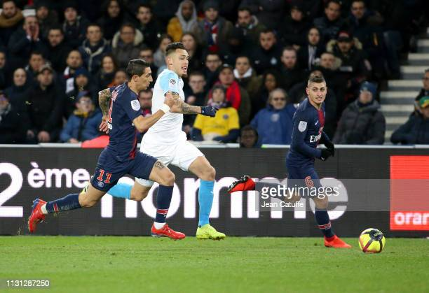 Lucas Ocampos of Marseille between Angel Di Maria and Marco Verratti of PSG during the French Ligue 1 match between Paris SaintGermain and Olympique...