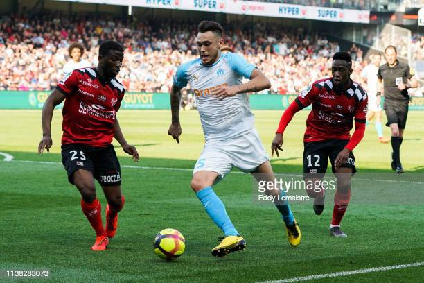 Lucas Ocampos of Marseille between Cheick Traore of Guingamp and Yeni Ngbakoto of Guingamp during the Ligue 1 match between EA Guingamp and Olympique...