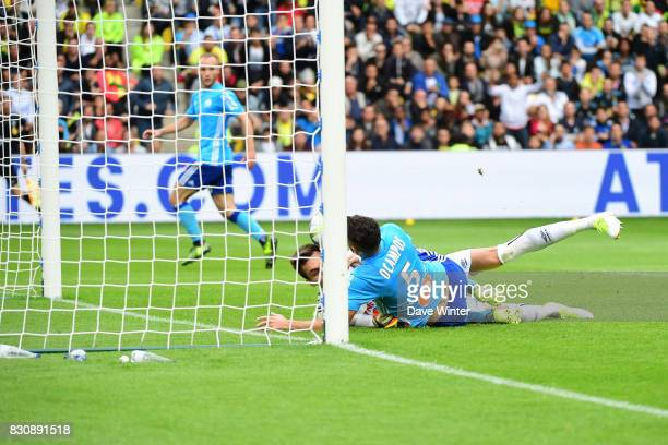 Lucas Ocampos of Marseille bundles the ball over the line to put his side 10 ahead during the Ligue 1 match between FC Nantes and Olympique Marseille...