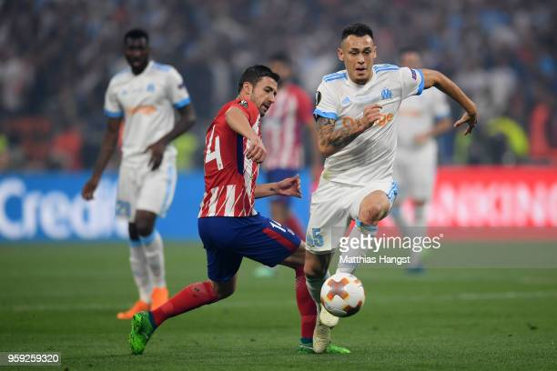 Lucas Ocampos of Marseille gets away from Gabi of Atletico Madrid during the UEFA Europa League Final between Olympique de Marseille and Club...