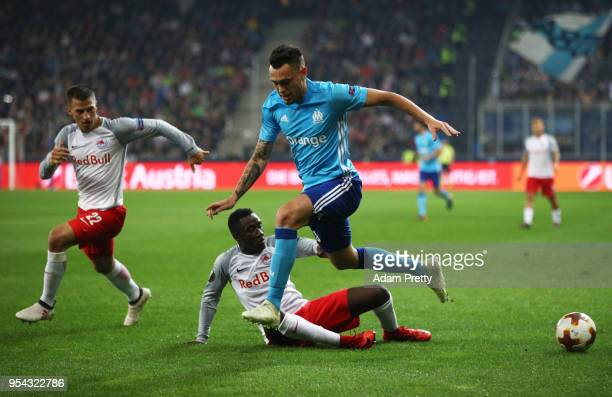 Lucas Ocampos of Marseille is tackled by Diadie Samassekou of Red Bull Salzburg during the UEFA Europa Semi Final Second leg match between FC Red...