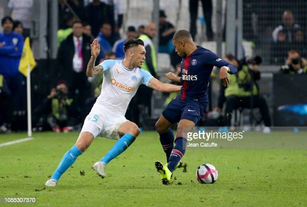 Lucas Ocampos of Marseille Kylian Mbappe of PSG during the french Ligue 1 match between Olympique de Marseille and Paris SaintGermain at Stade...